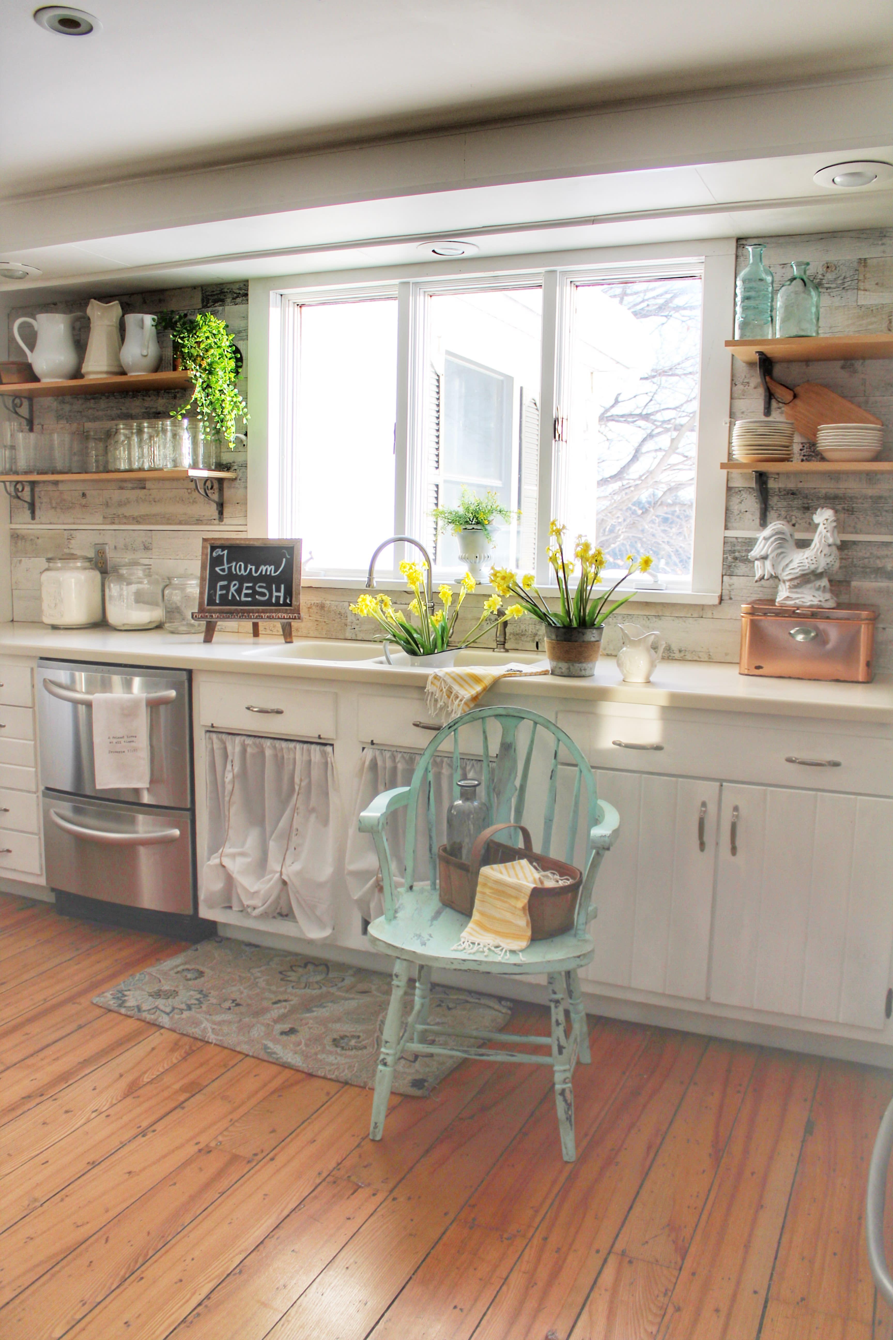 Kitchen sink with reclaimed barnwood backsplash created with Stikwood peel and stick wood planks.