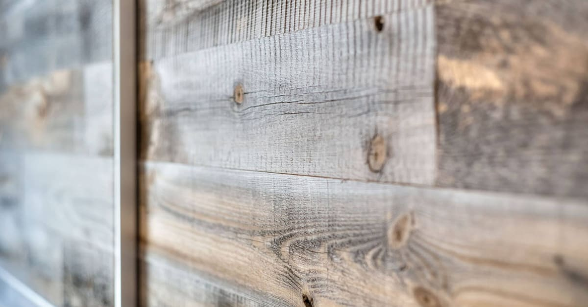 Closeup of closet doors showing the grain and beauty of Stikwood  DIY real reclaimed peel and stick panels milled from real barnwood.
