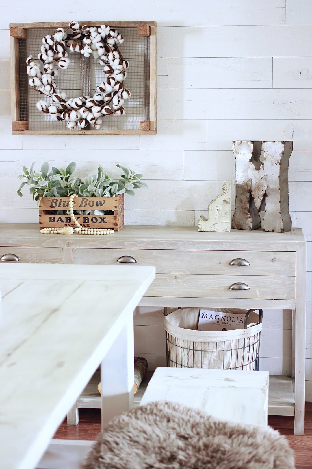 Dining room with reclaimed wood accent wall in Hamptons peel and stick wood planks by Stikwood creates the perfect shiplap look.