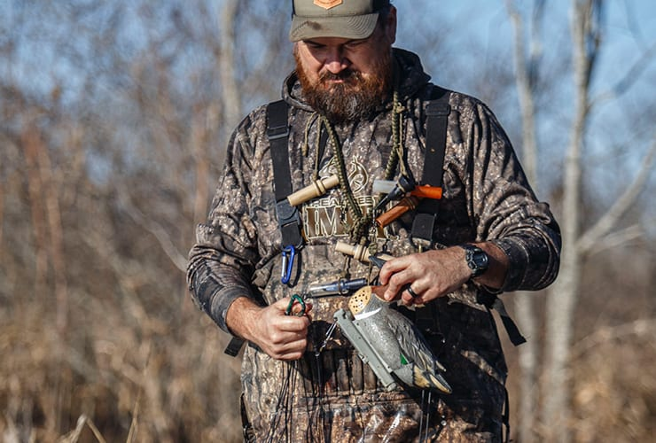 Justin Martin fiddling with a duck decoy