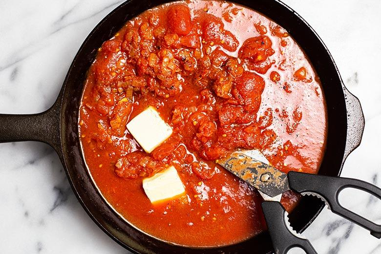 canned tomatoes and butter in skillet