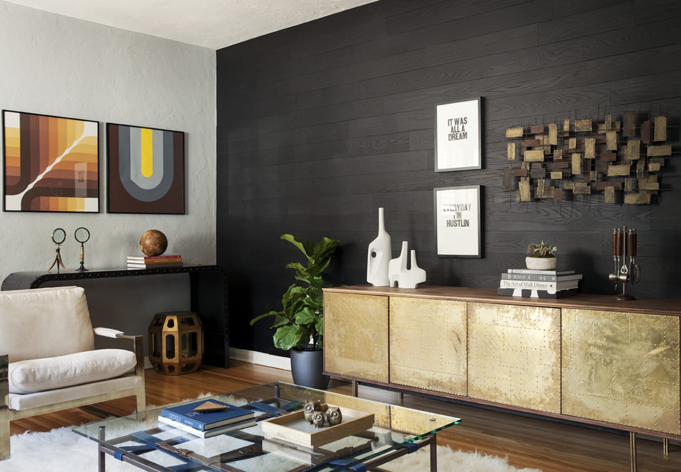 Midcentury modern living room with a Stikwood peel and stick real wood plank focal wall with dark, black color.
