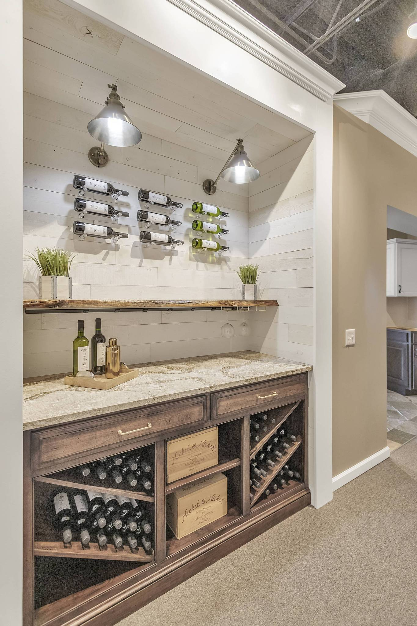 E.W. Kitchen showroom presentation of wine bar and Hamptons peel and stick wood planks that creates a nice shiplap look.