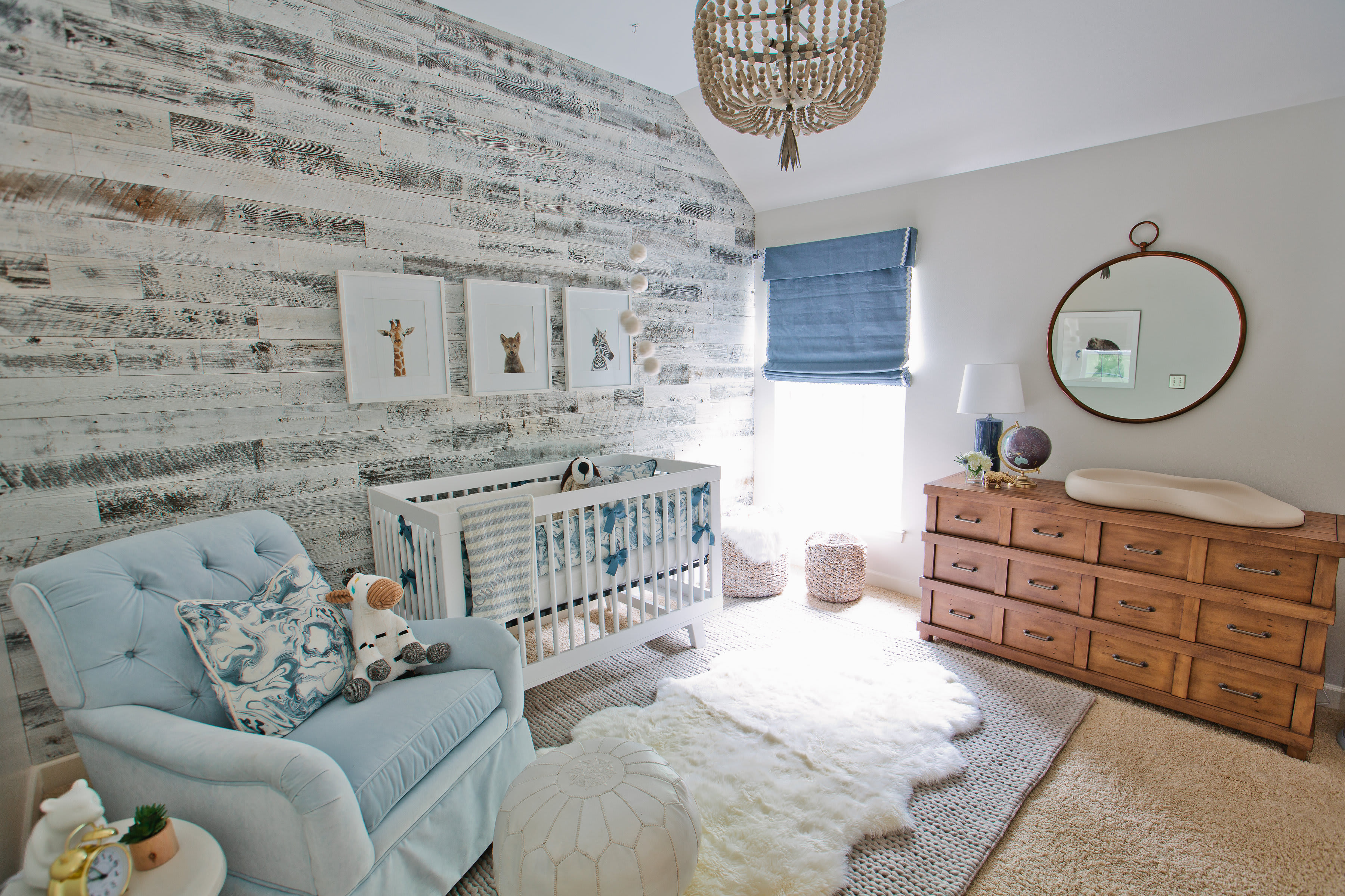 Fun nursery with a reclaimed barnwood feature wall created with Stikwood peel and stick planks.