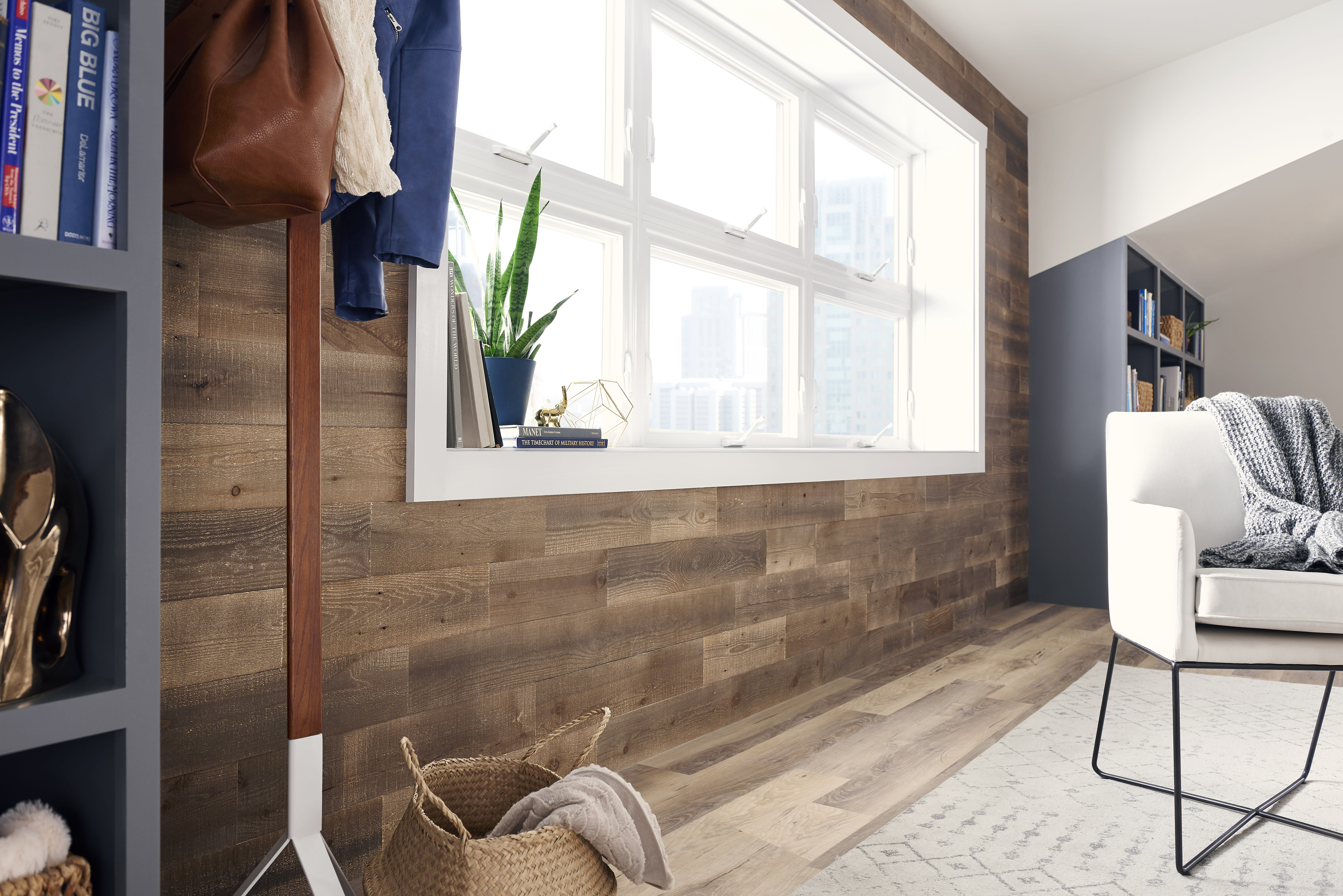 Reclaimed wood accent wall in a home office featuring Stikwood reclaimed peel and stick planks in a brown color called Hazelnut.