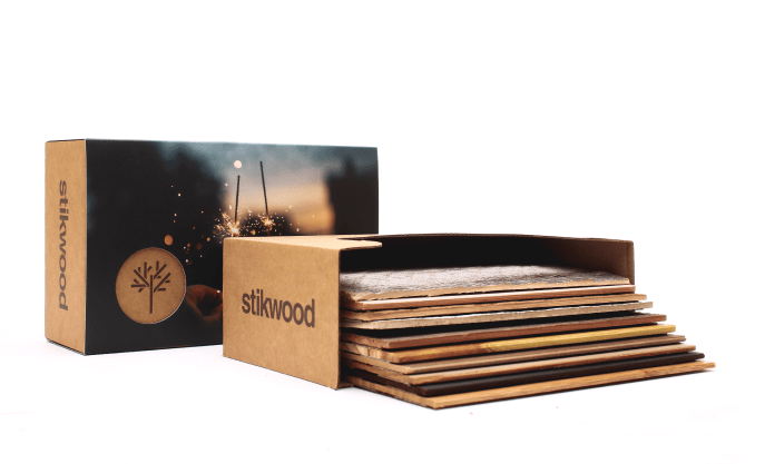 Stikwood peel and stick real wood plank sample boxes.