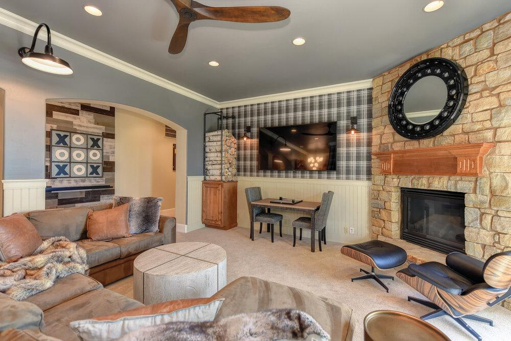 Todd peddicord designed game room with Stikwood reclaimed wood wall accents.