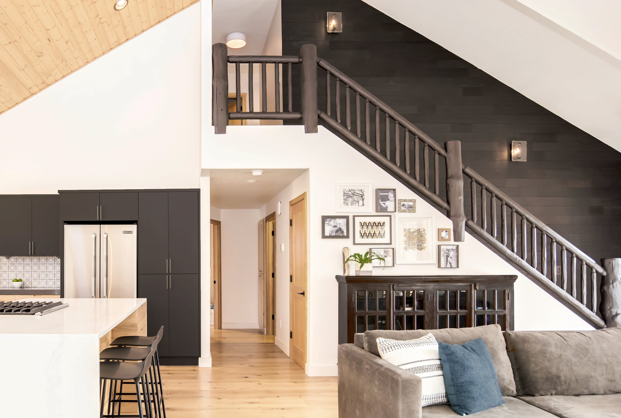 Pj Hurst home design featuring light and dark wood accents including Stikwood Charcoal peel and stick sustainable wood wall planks.