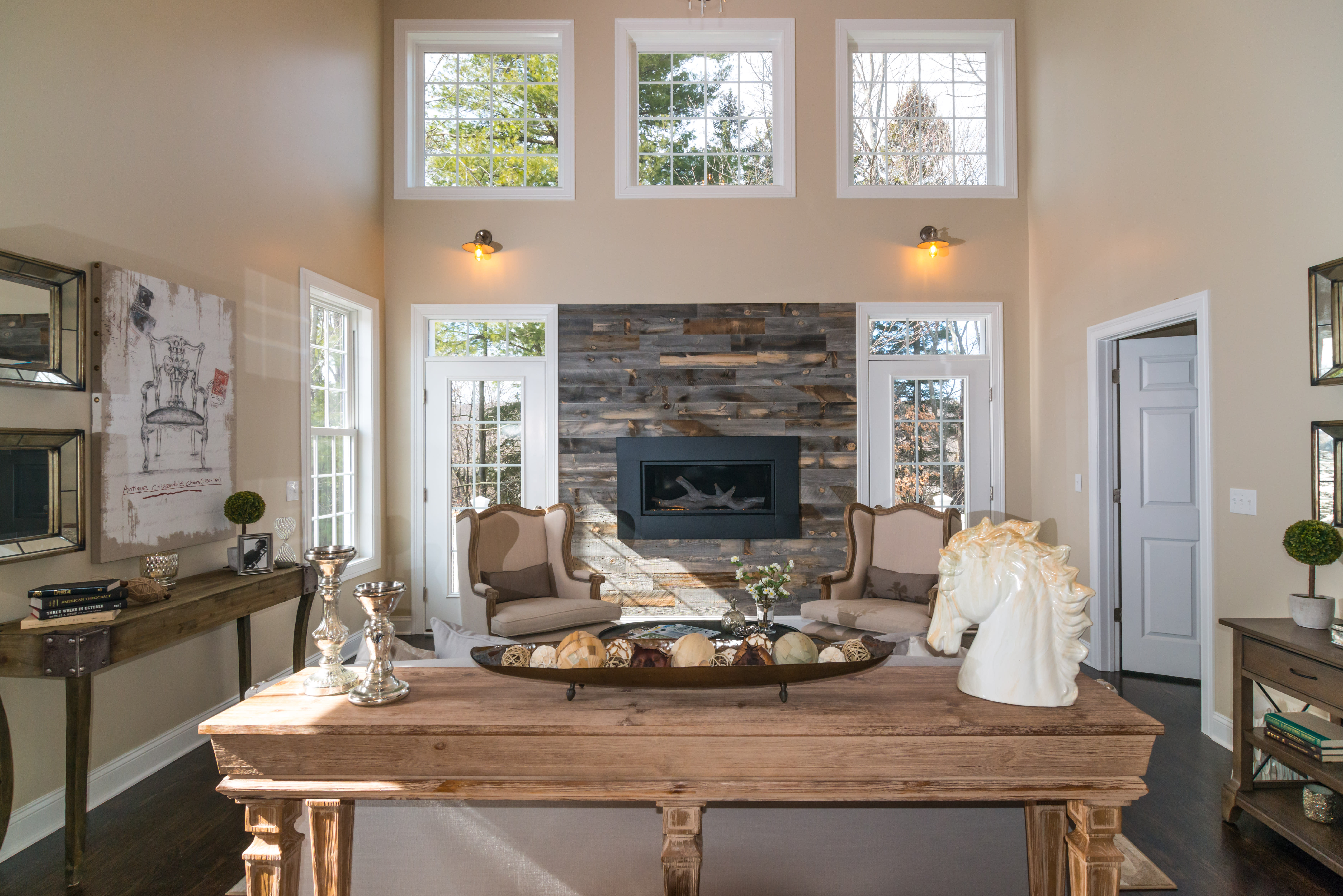 Traditional living room featuring a fireplace surround created with Stikwood peel and stick real reclaimed weathered wood panels.