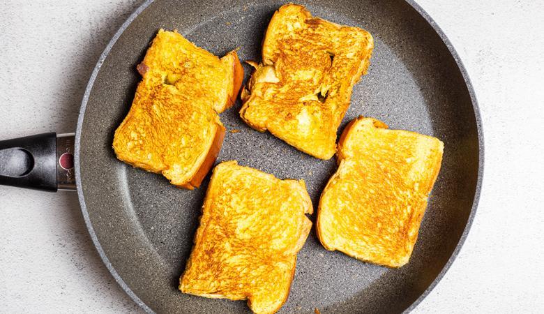 slices in bread toasting in skillet