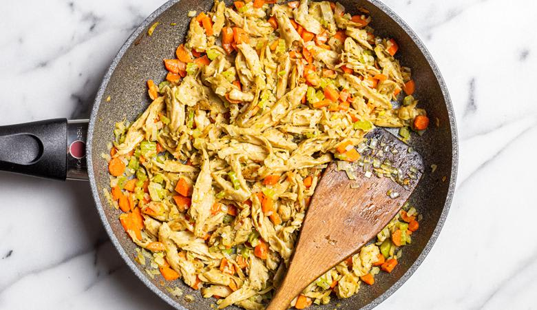 Plant based chicken pieces in skillet