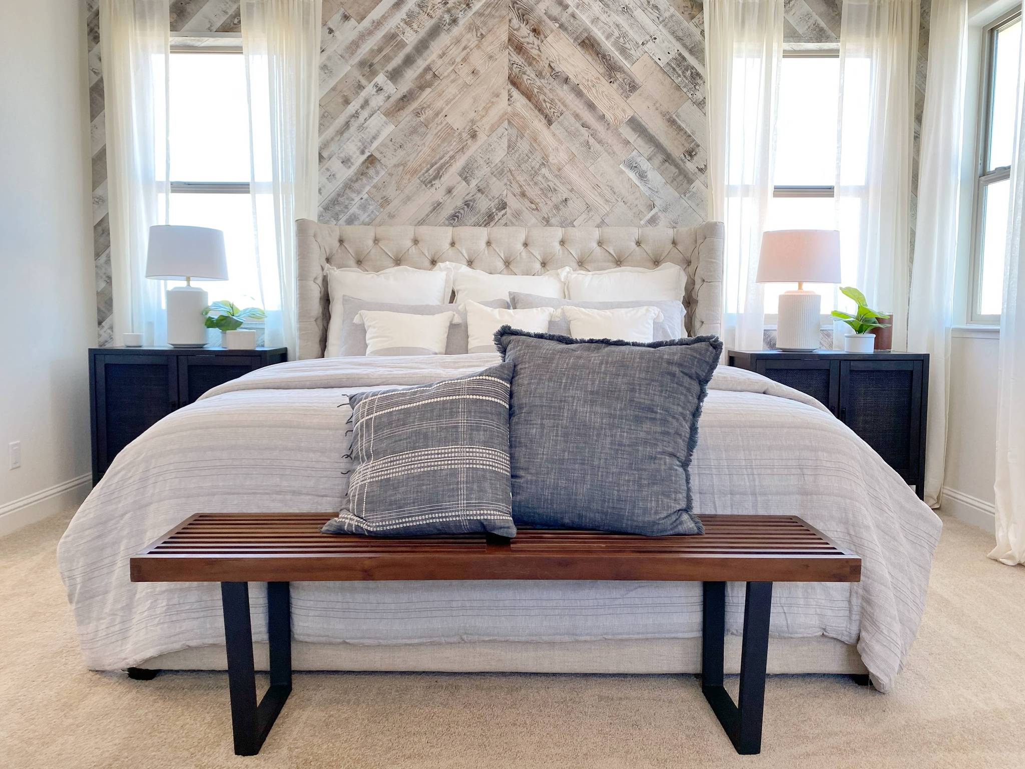 Granville homes bedroom featuring a chevron Stikwood peel and stick reclaimed white wood feature wall.