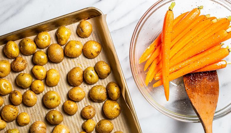 Halved potatoes on a baking sheet