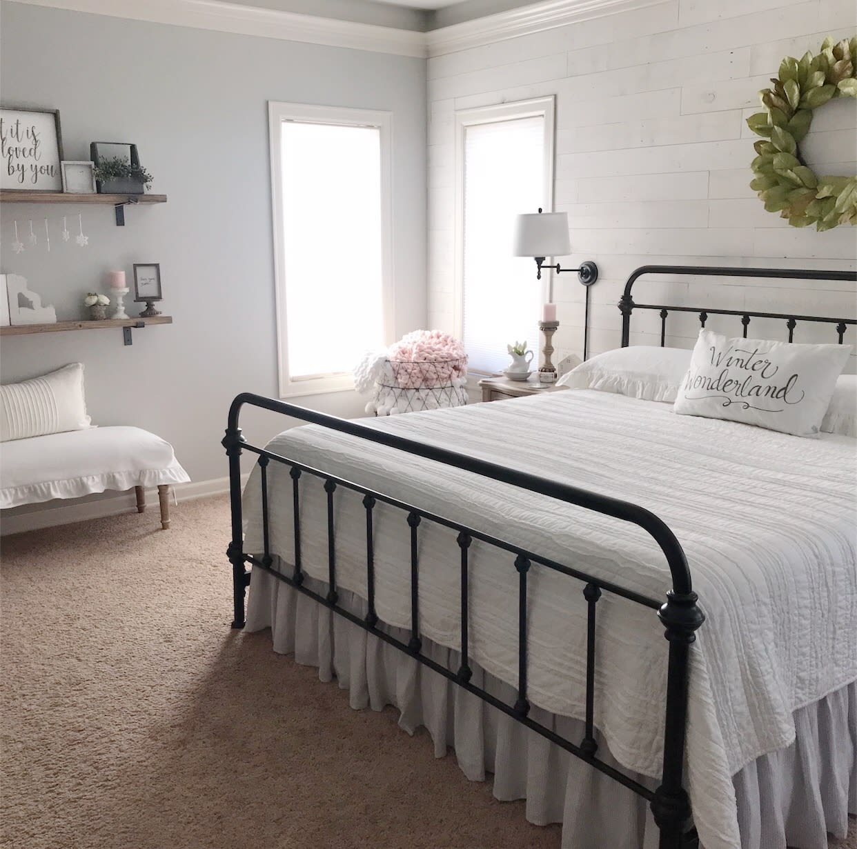 Classic farmhouse style bedroom with a Hamptons finish feature wall  made with peel and stick wood wall planks by Stikwood.