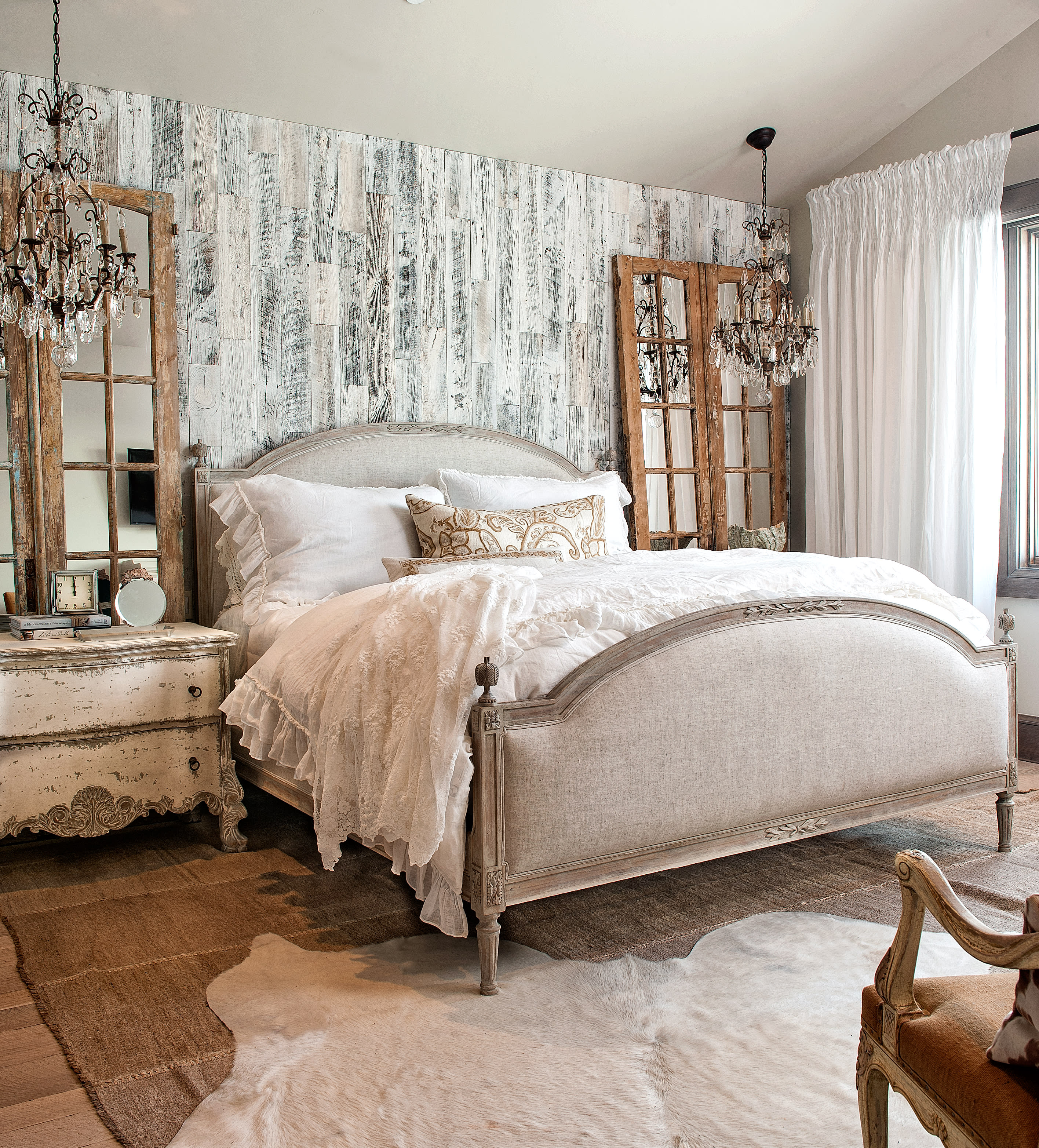 Eclectic maximalist bedroom design featuring a stikwood peel and stick reclaimed weathered wood accent wall.