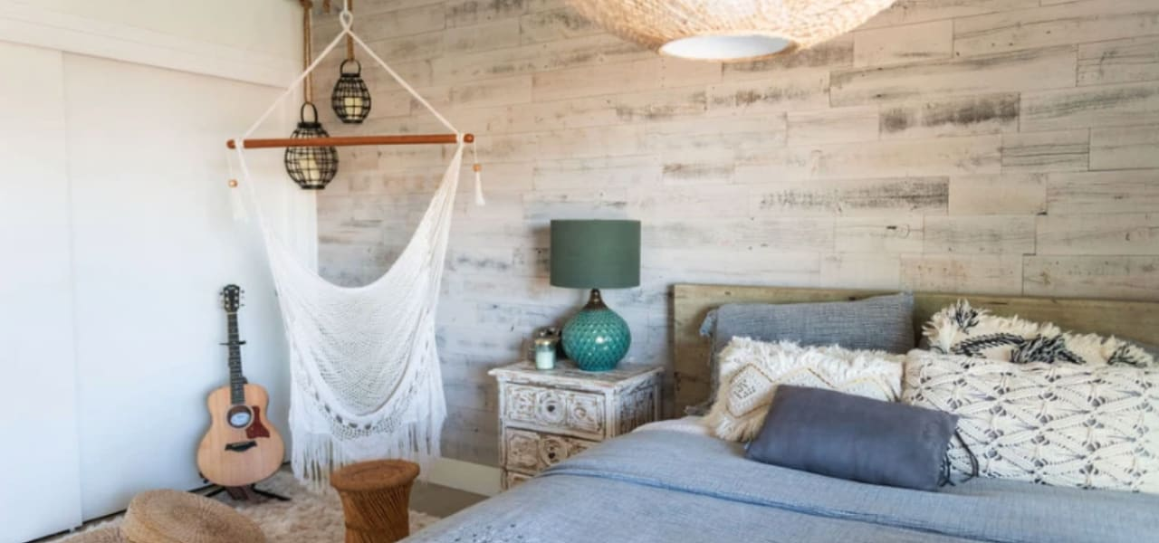 Bohemian bedroom design featuring a stikwood reclaimed barnwood accent and feature wall in white.