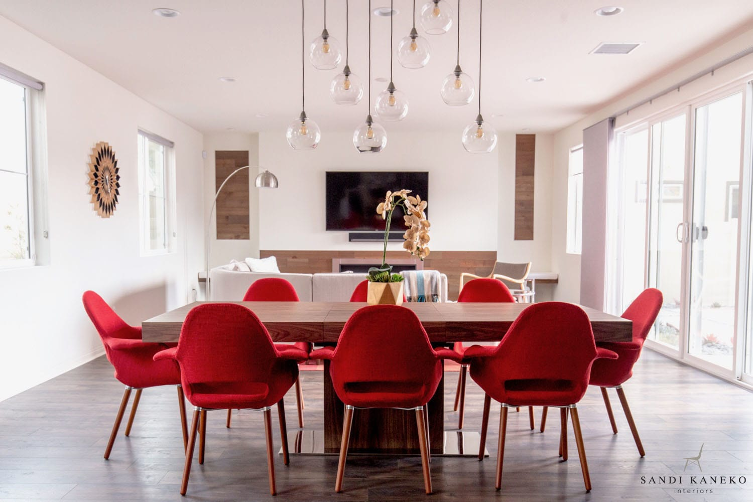 Modern clean great room with dining table and fireplace and Stikwood peel and stik wood accent walls in Vandyke finish.