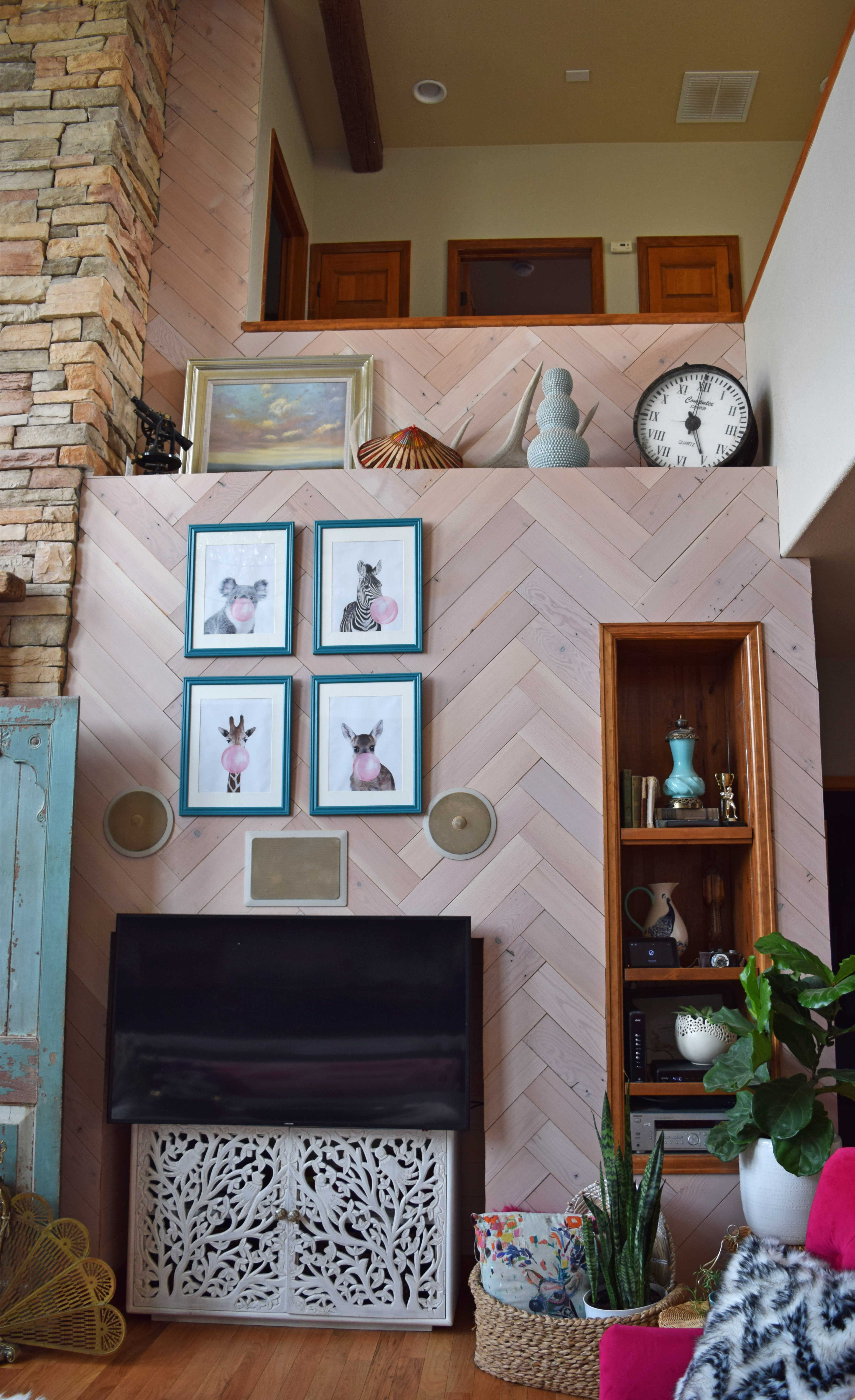 Southwest style BOHO living room with herringbone installation of Minimalist fir Stikwood peel and stik wood wall and ceiling planks.
