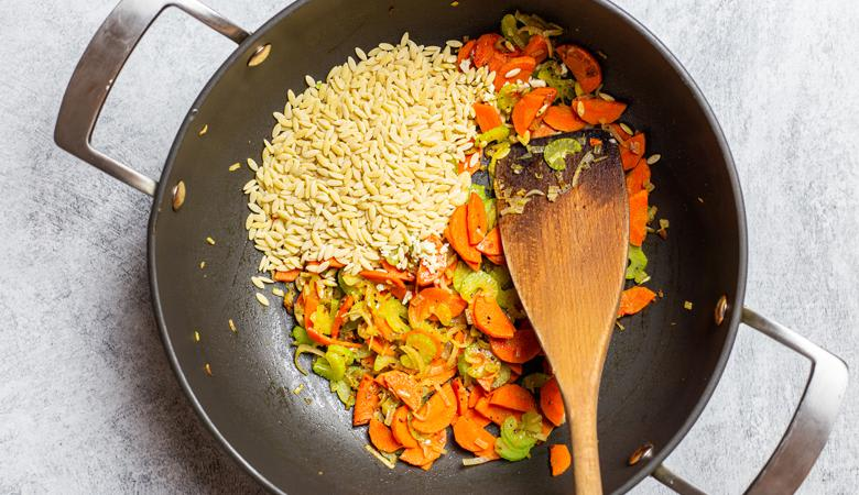 orzo rice, shallots, carrot and celery in wok