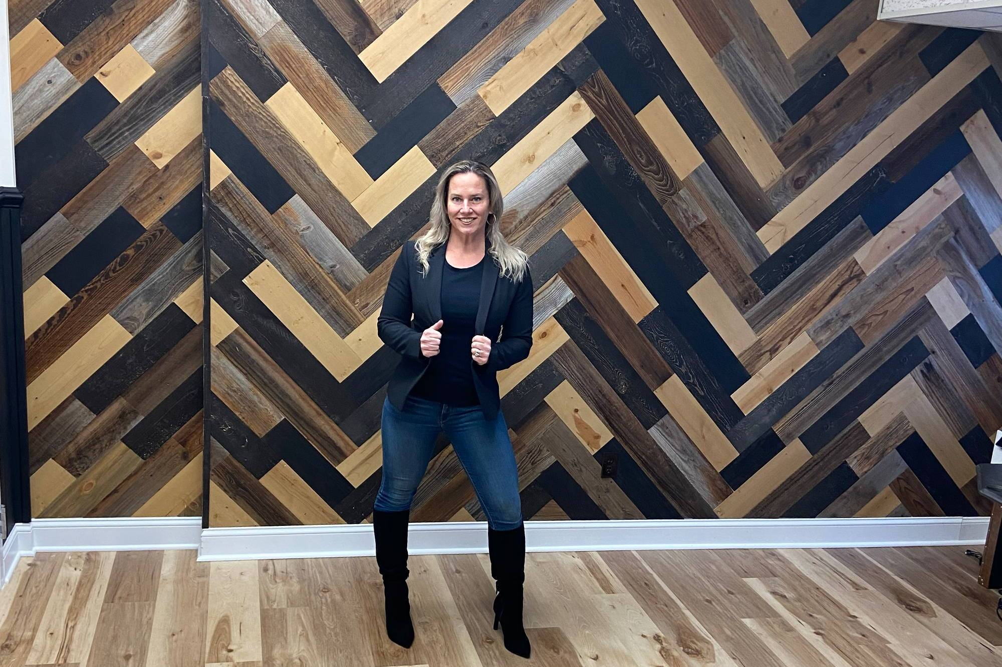 large feature wall designed by Jay C that mixes several reclaimed wood wall plank finishes from the Stikwood peel and stik wood wall collection.