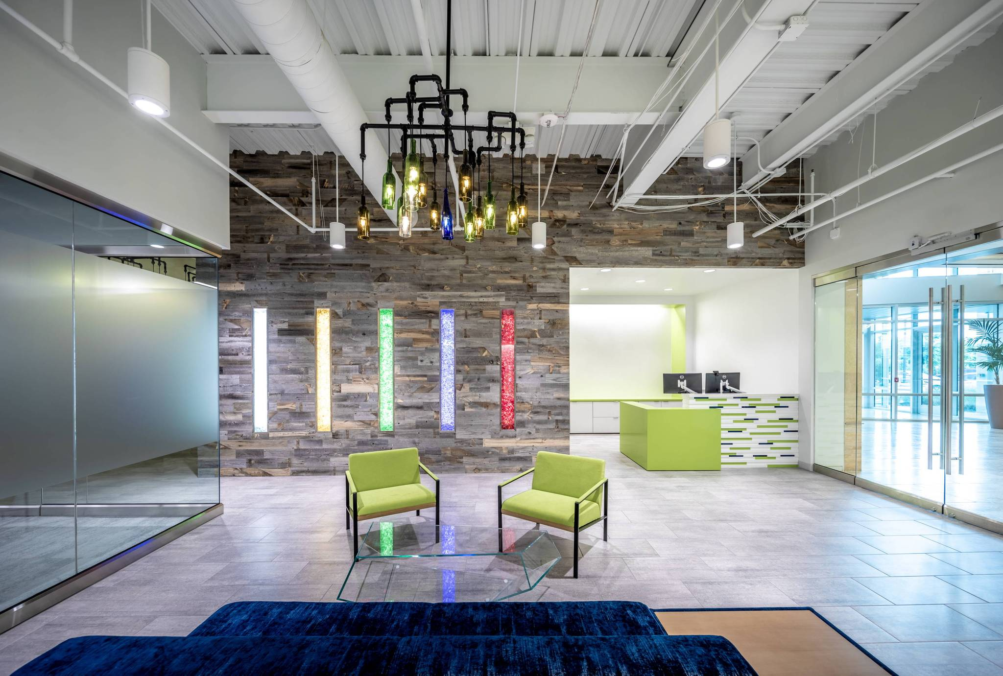 n2design created this lobby for Strategic materials a glass recycling company that combines recycled glass and reclaimed wood to beautiful effect.