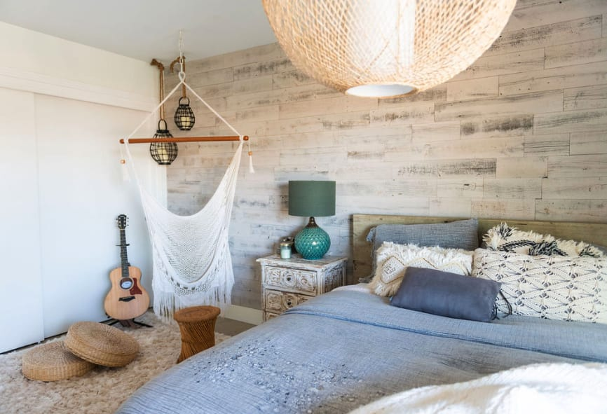 Light and bright BOHO bedroom design featuring white reclaimed wood Stikwood peel and stick accent wall.