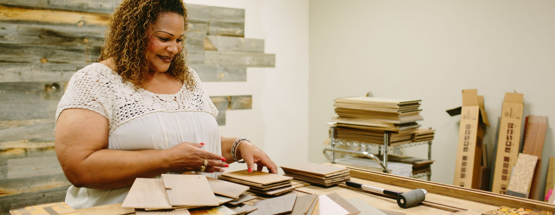 Stikwood worker looking at plankprint samples on a desk.