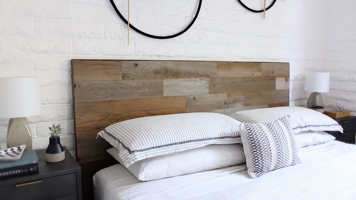 Masculine bedroom with a reclaimed sierra silver Stikit peel and stick wood headboard kit.