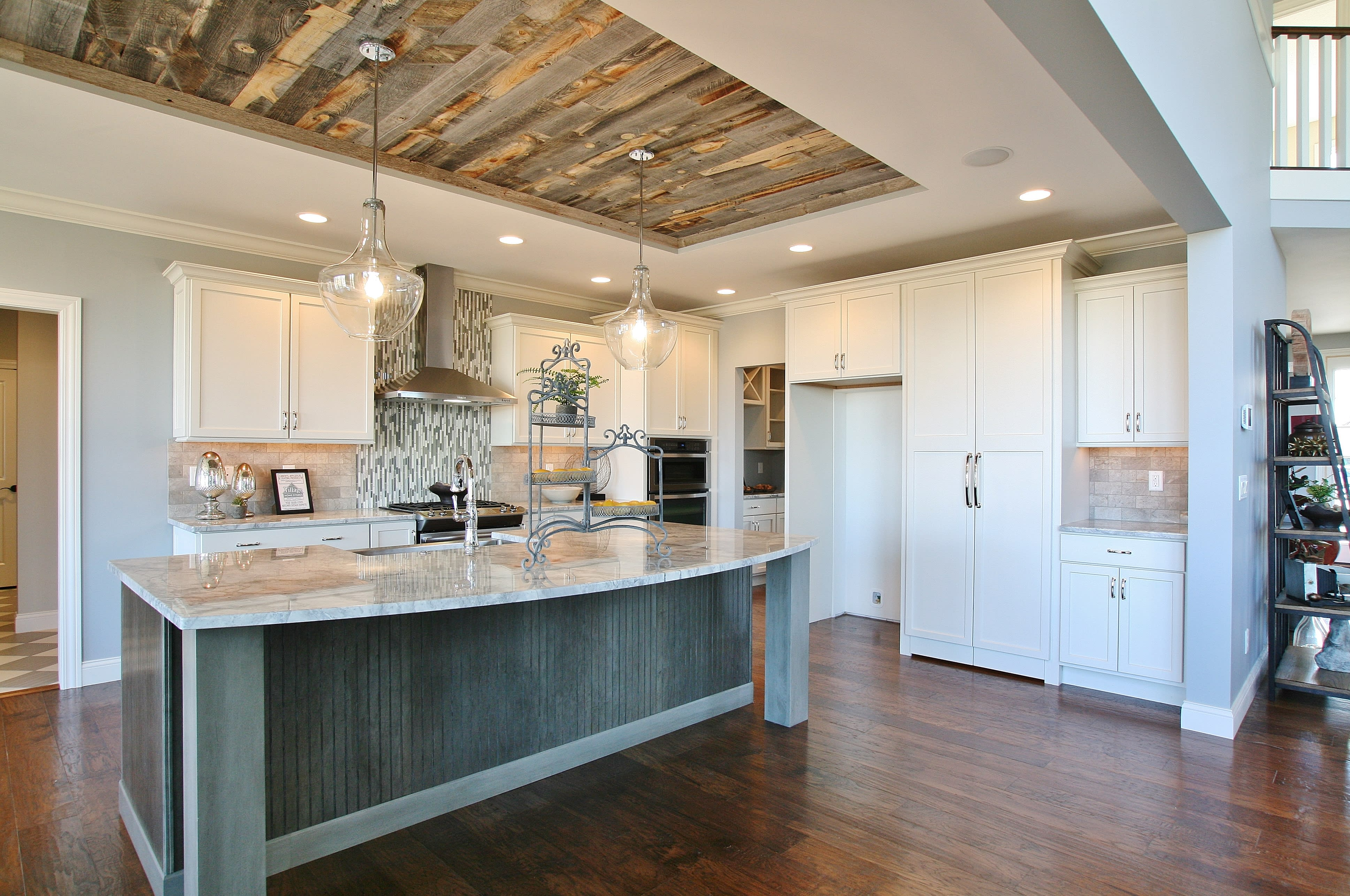 Tray ceiling in a traditional style kitchen filled with real reclaimed wood planks from Stikwood.