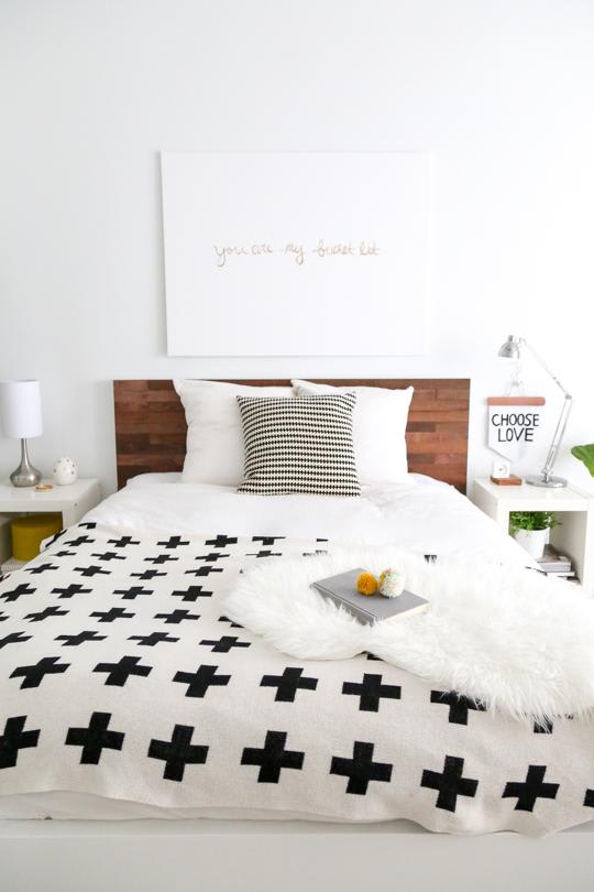 Large bed in master bedroom with a Srtikit reclaimed wood headboard DIY kit.