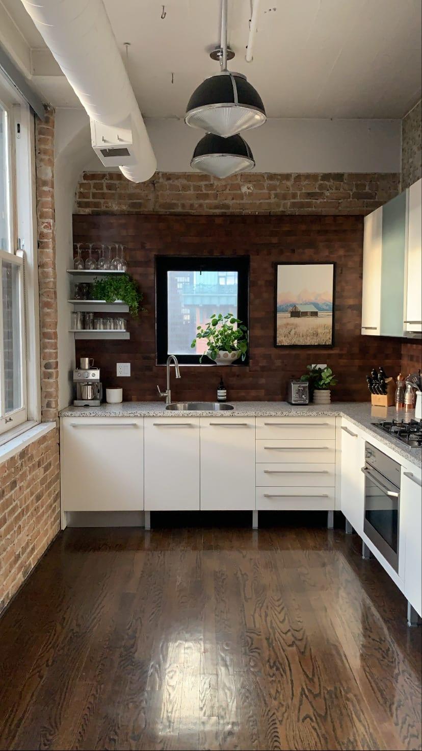 Kyle Schuneman's kitchen backsplash remodel using reclaimed barrel oak peel and stick wood planks over tile.