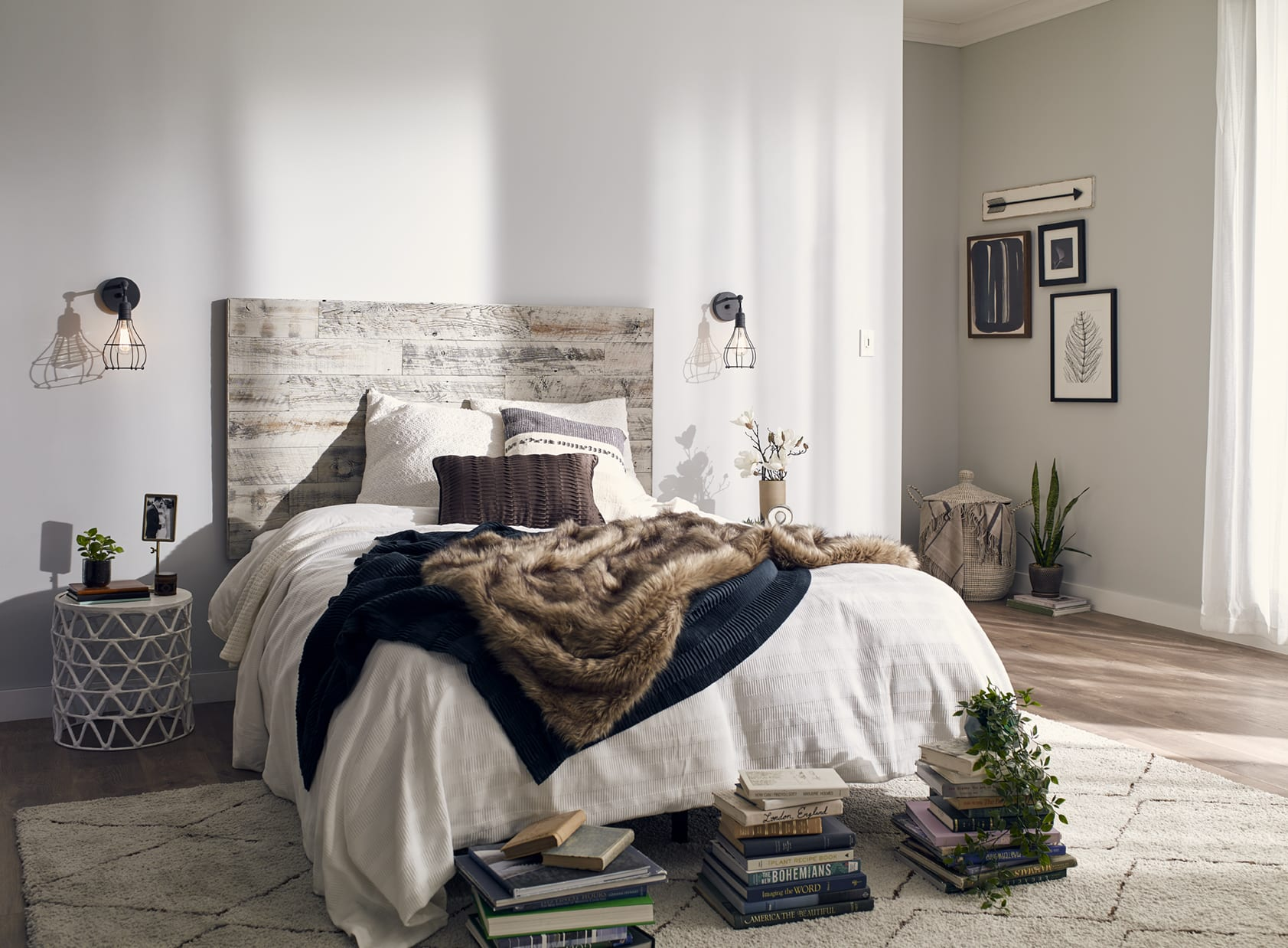 Light and bright contemporary bedroom with comfortable bed and a Stikwood Stikits reclaimed wood DIY headboard kit.