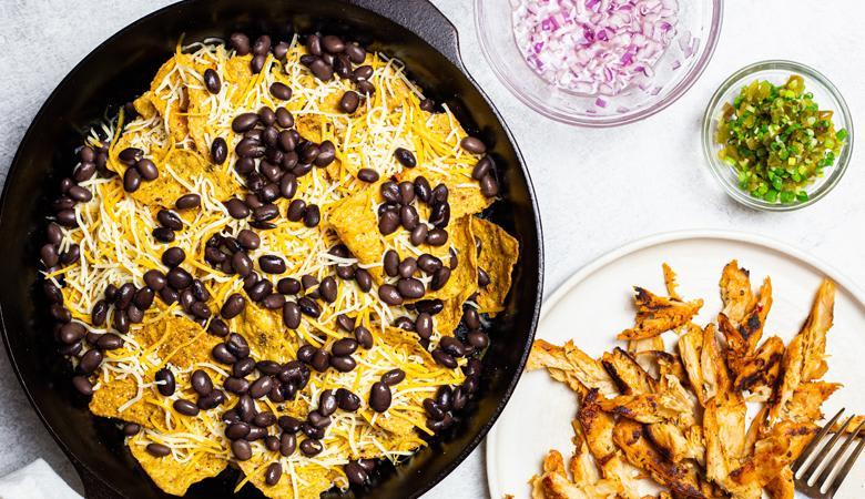 Nacho ingredients cooking in skillet