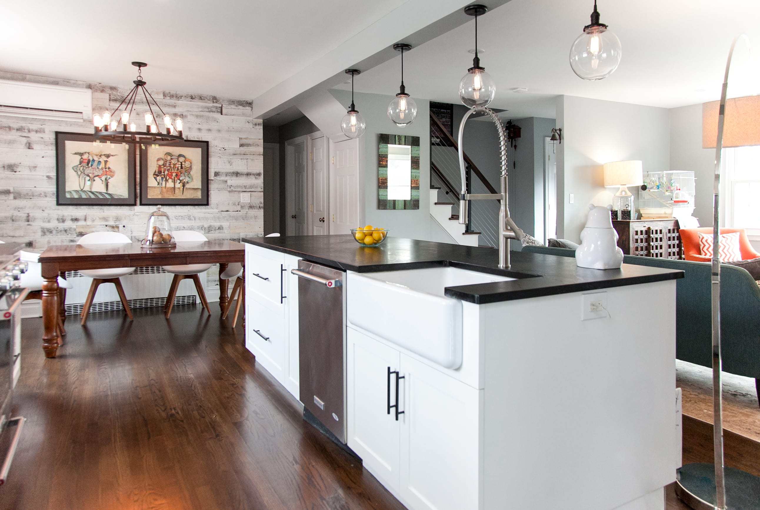 Kitchen with a dining area with a white Stikwood peel and stick reclaimed barnwood accent wall.
