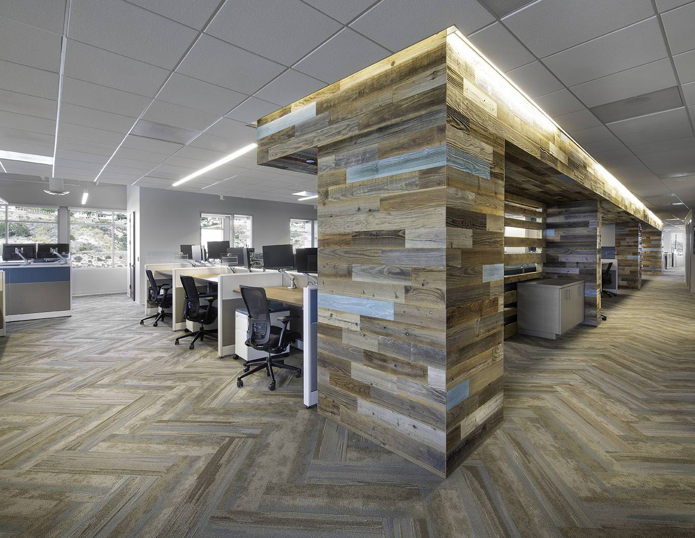 Interplan designed this open office with natural elements like stikwood peel and stick real reclaimed accent walls.