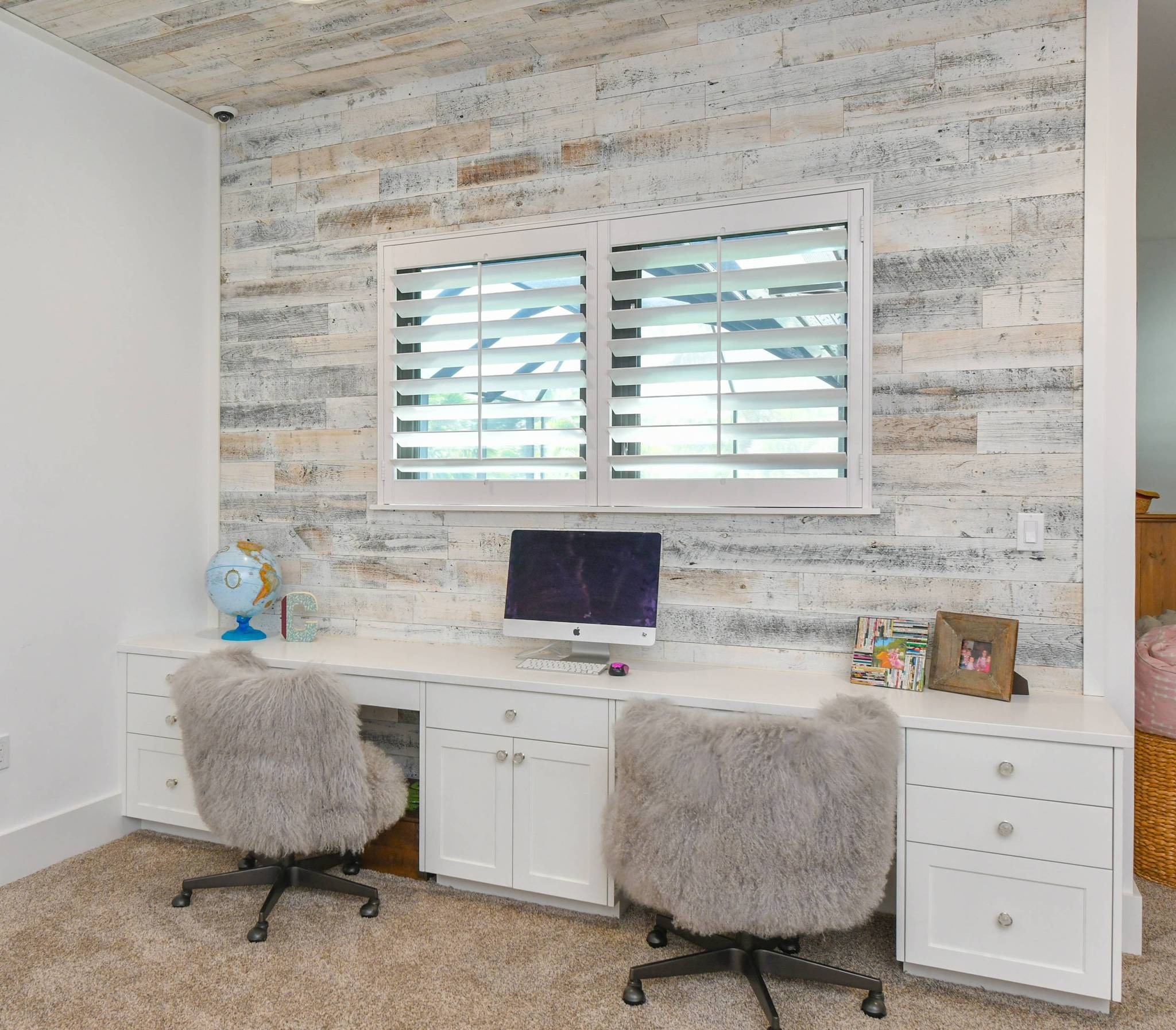 Home office concept by Trademark Interiors that uses a large Stikwood peel and stick reclaimed wood plank wall as the focus of the room.