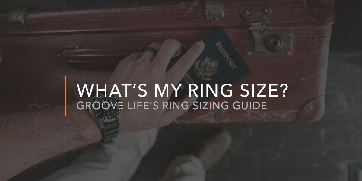 hand holding a large travel bag and passport with a groove ring on their finger