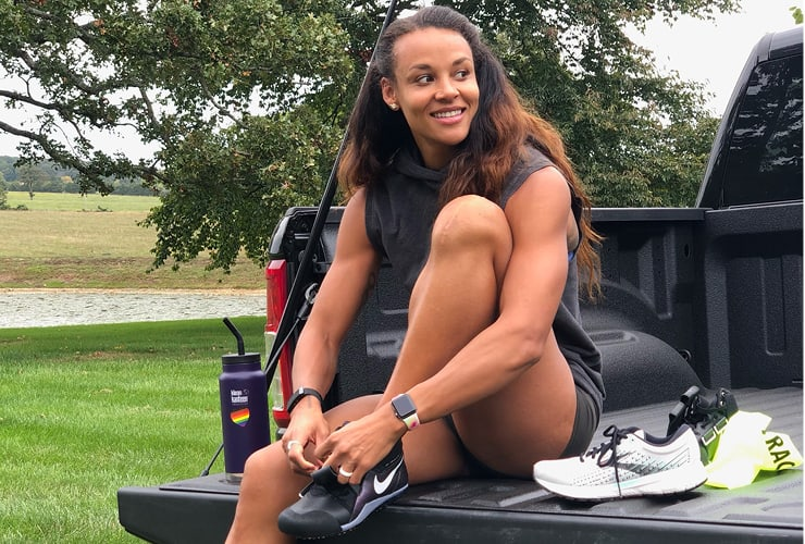 Chantae McMillan tying her shoes before a workout