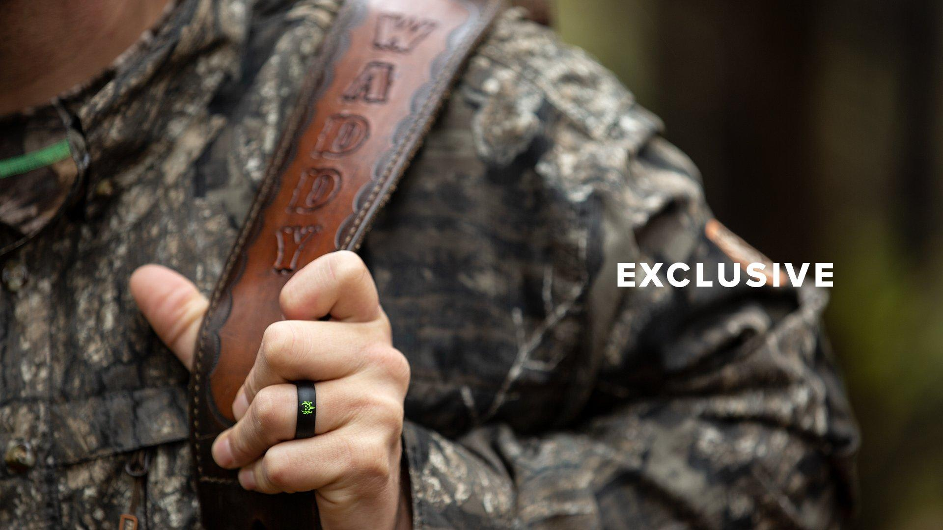 Excusive, man in camo holding a leather gun strap