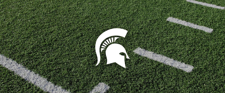Michigan State logo on football field