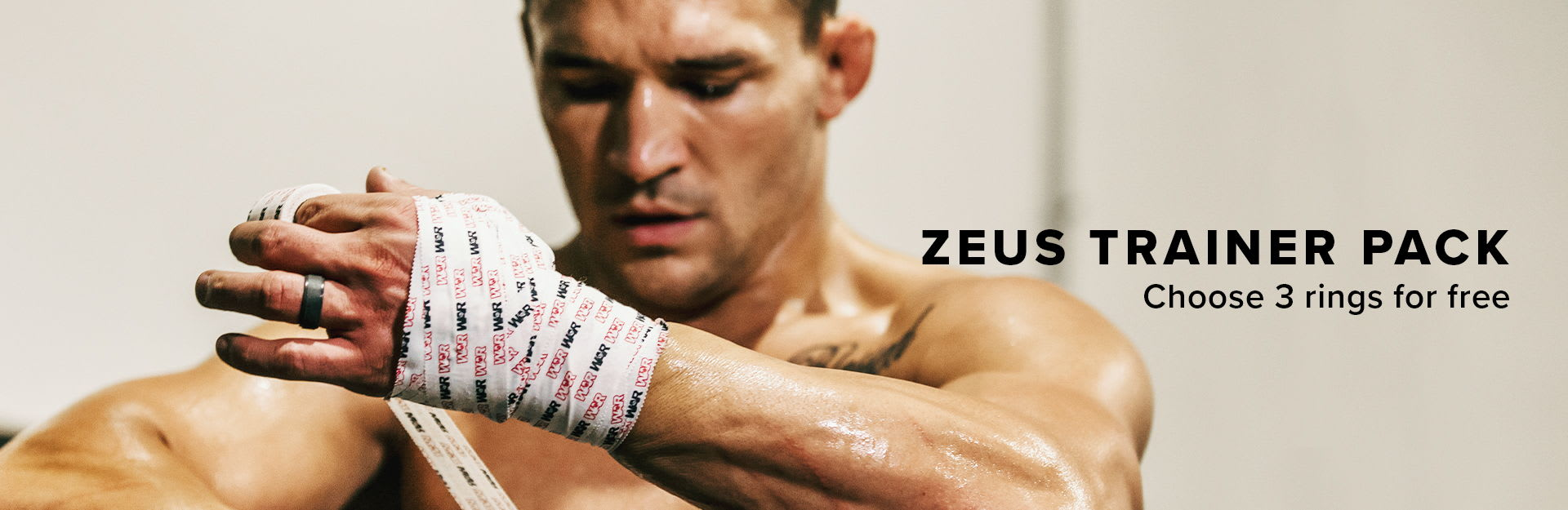 Zeus Trainer Pack, Michael Chandler wrapping his hands in preparation for a match