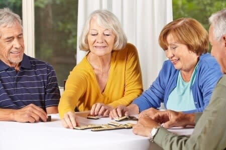 Senior Woman Playing Game with Friends