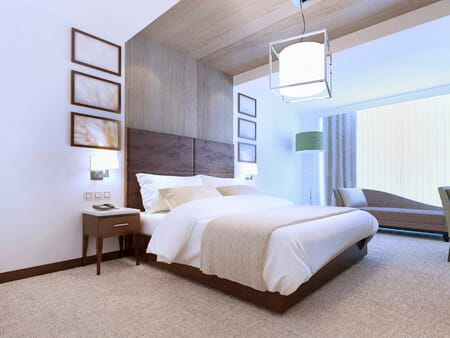 large bedroom with vaulted ceiling, white walls, spacious, open