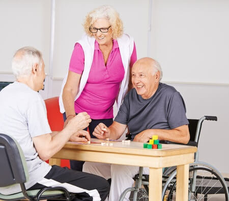 three aged caucasians playing board game