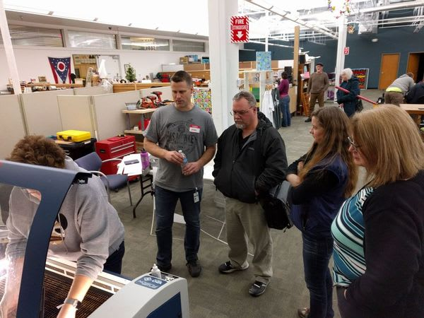Members watching demonstration of laser cutting