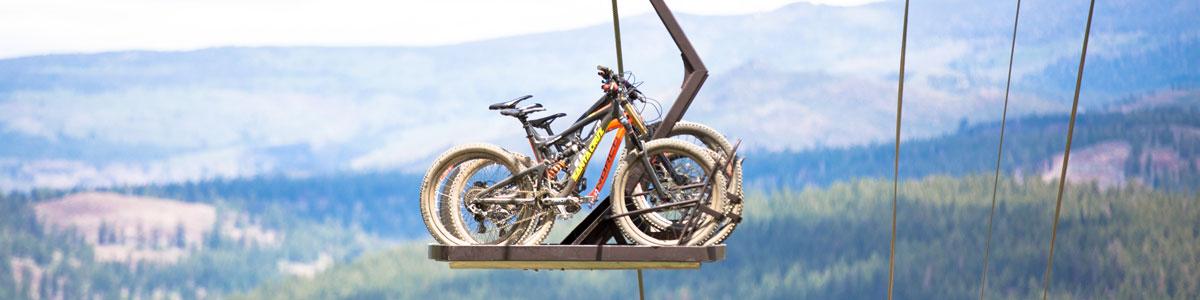 Santa Cruz Bronson mountain bike on bike park lift - Shuttlebuddies MTB