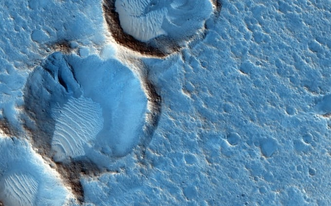 This close-up from the Mars Reconnaissance Orbiter's HiRISE camera shows weathered craters and windblown deposits in southern Acidalia Planitia. A striking shade of blue in standard HiRISE image colors, to the human eye the area would probably look grey or a little reddish.