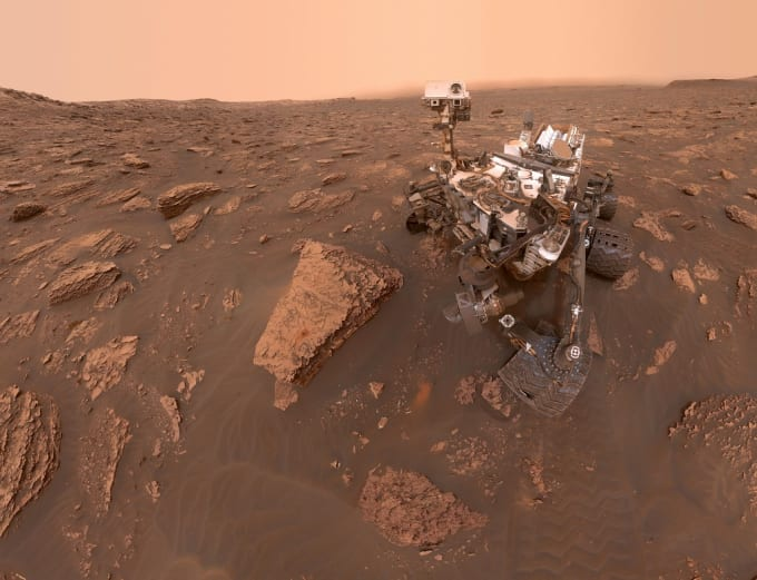 Winds on Mars can't actually blow spacecraft over. But in the low gravity, martian winds can loft fine dust particles in planet-wide storms, like the dust storm now raging on the Red Planet. From the martian surface on sol 2082 (June 15), this self-portrait from the Curiosity rover shows the effects of the dust storm, reducing sunlight and visibility at the rover's location in Gale crater.