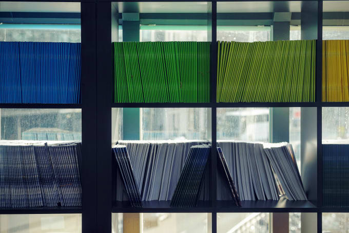 Shelves of multi-colored folders