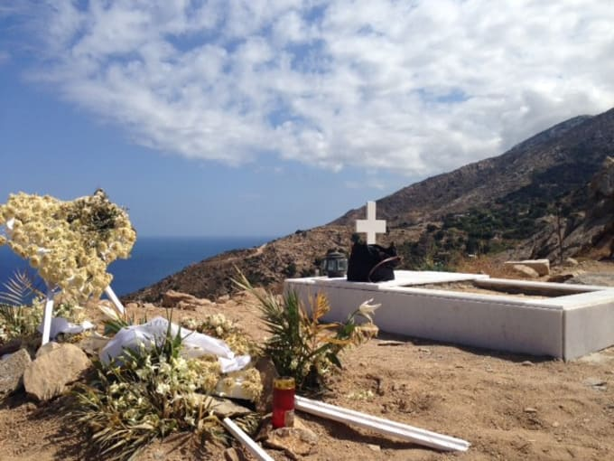 Two graves on a mountain overlooking the Aegean Sea, one fresh